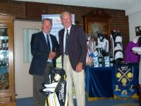 Division 4 winner Brian Smith receiving his prize from the Club Captain. Congratulations Brian.